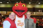 Vice Provost Curt Coonrod_ the new mascot and Chancellor George at the unveiling of the mascot at a basketball game_.jpg